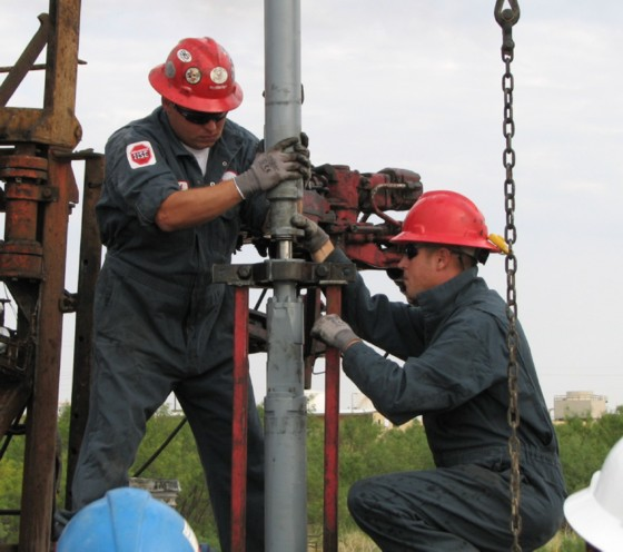 Workers drilling an oil well